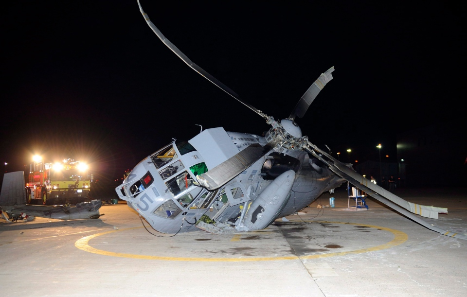 A Canadian Sea King helicopter is shown laying on its side in Shearwater, Nova Scotia. ( RCAF handout)