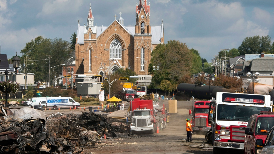 Ste-Agnes Church is seen as work continues at the crash site of the train derailment and fire in Lac-Megantic, Que., on Tuesday, July 16, 2013. (Ryan Remiorz / THE CANADIAN PRESS)
