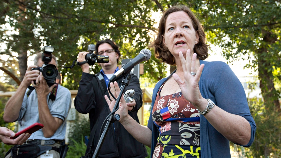 Alberta Premier Alison Redford speaks during the Premier's annual K-Days Pancake Breakfast about MLA Mike Allen's resignation in the wake of his arrest on prostitution charges in Minnesota in Edmonton, Alberta on Thursday July 18, 2013. (Jason Franson / THE CANADIAN PRESS)