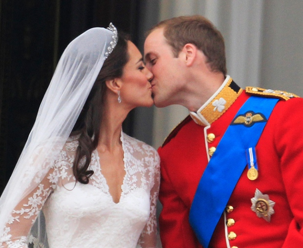 Prince William kisses his wife Kate, Duchess of Cambridge on the balcony of Buckingham Palace after the royal wedding in London Friday, April, 29, 2011. (AP / Matt Dunham)