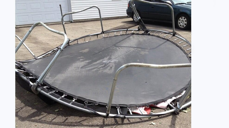 Heavy winds tossed a trampoline several metres on Plateau Ouimet in Laval Friday evening. (Image CTV Montreal, July 20 2013).
