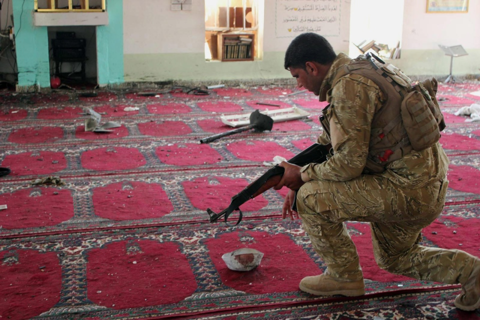 An Iraqi army soldier inspects the damage inside the Abu Bakr Mosque in Baqouba, northeast of Baghdad, Iraq, Friday, July 19, 2013. (AP)