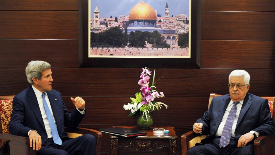 U.S. Secretary of State John Kerry, left, meets with Palestinian President Mahmoud Abbas in the West Bank city of Ramallah, on Friday, July 19, 2013. (AP / Mandel Ngan)