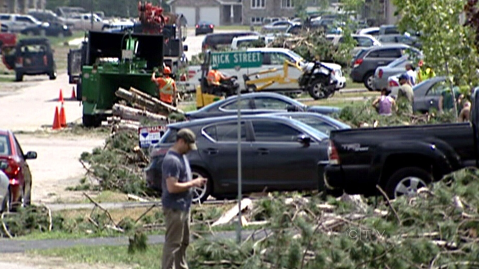 Residents cleanup after a massive summer storm in Petawawa, Ont., Saturday, July 20, 2013.
