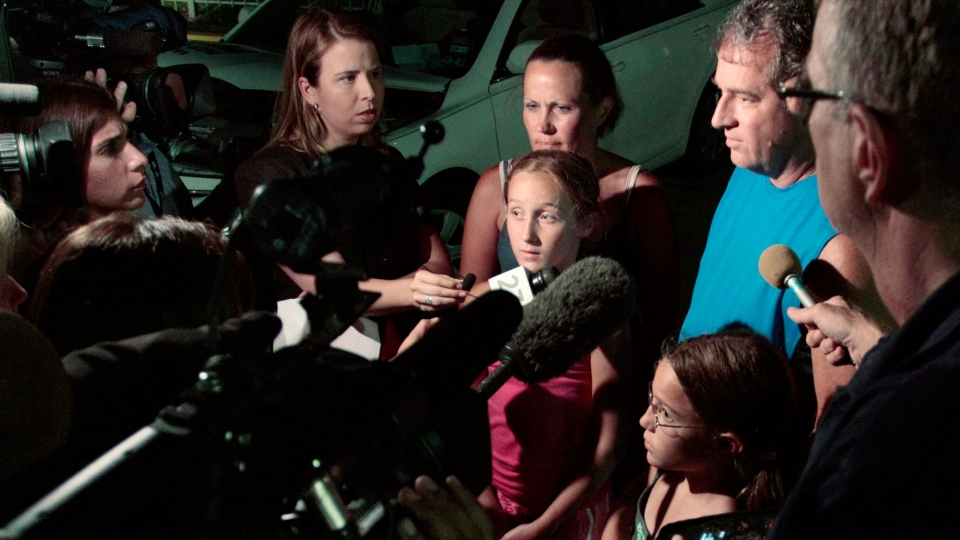 Members of the Putnam family, who were present when a woman who died while riding a roller coaster, are interviewed by reporters at Six Flags Over Texas in Arlington, Texas on Friday, July 19, 2013. (The Fort Worth Star-Telegram, Ian McVea)