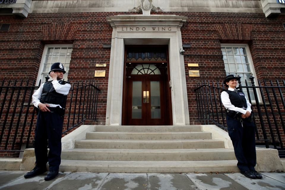 Officers with London's Metropolitan Police Service stand guard outside St. Mary's Hospital, where Kate is admitted and currently in labour, Monday, July 22, 2013. (AP / Lefteris Pitarakis)