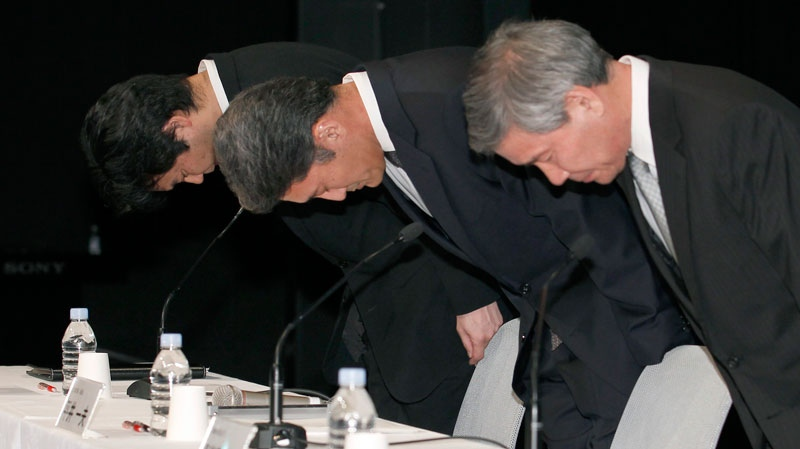 Sony Computer Entertainment President and CEO Kazuo Hirai, center, bows along with two other executives at the start of a press conference at the Sony Corp. headquarters in Tokyo Sunday, May 1, 2011.  (AP Photo/Shizuo Kambayashi)
