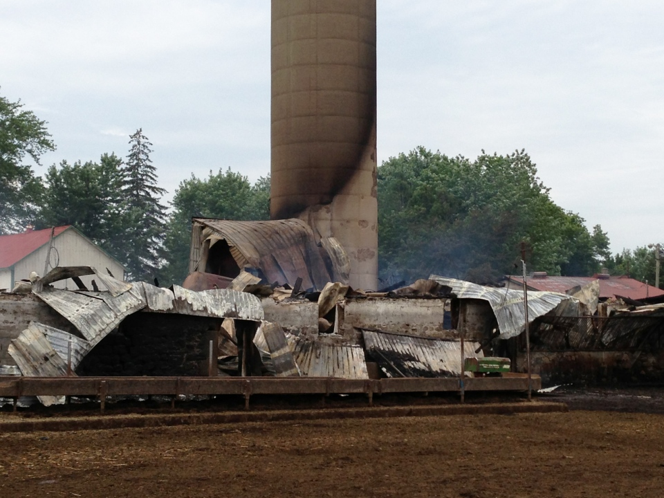 Remains of a barn are seen following a fire that killed more than 100 cattle on Monday, July 22, 2013. (Brian Dunseith / CTV Kitchener)