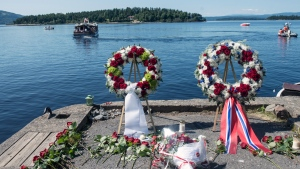 Wreaths and flowers lay on the shore after a wreath laying ceremony to mark the second year anniversary of the twin Oslo-Utoeya massacre by self confessed killer Anders Breivik, at Utvika Monday, July 22, 2013. (AP / NTB Scanpix, Aleksander Andersen)