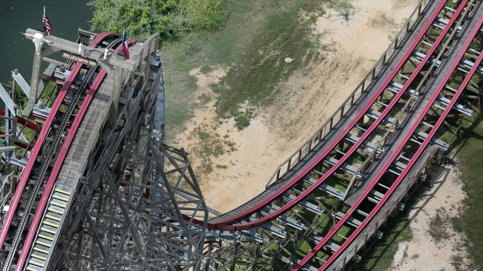 This aerial photo shows the Texas Giant roller coaster at Six Flags Over Texas where a woman fell to her death, in Arlington, Texas, Saturday, July 20, 2013. (The Dallas Morning News / Louis DeLuca)