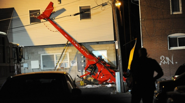 A helicopter that was carrying a reality television crew is shown after it crashed in Indiana, Pa., injuring three of the four people aboard, Saturday, April 30, 2011.  (AP / Post-Gazette, Rebecca Droke)