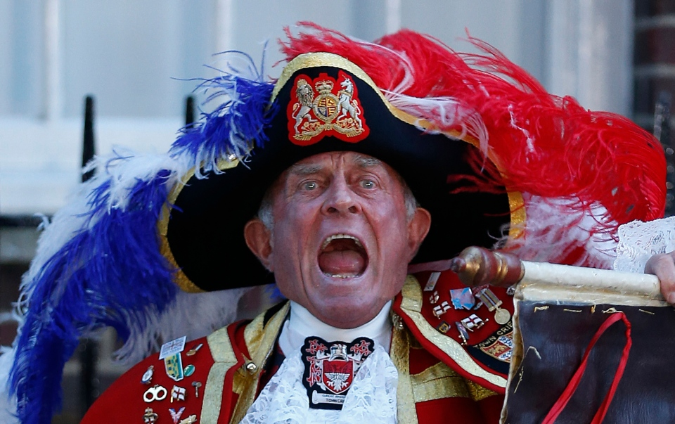 Tony Appleton, a town crier, announces the birth of the royal baby, outside St. Mary's Hospital exclusive Lindo Wing in London, Monday, July 22, 2013. (AP / Lefteris Pitarakis)