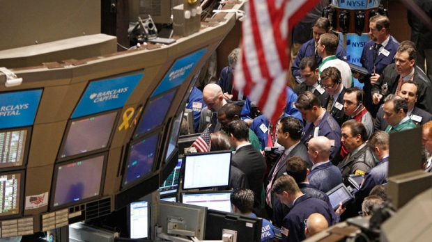 Traders work on the floor of the New York Stock Exchange in New York on April 19, 2011. (AP / Kathy Willens)
