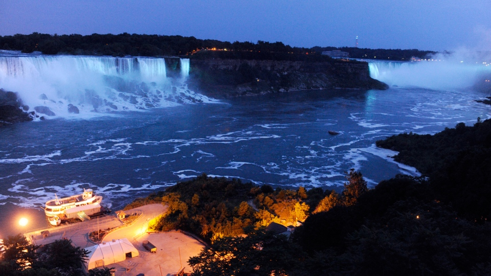 Niagara Falls is illuminated in blue to celebrate the birth of the Duke and Duchess of Cambridge's son. (AP / Gary Wiepert)