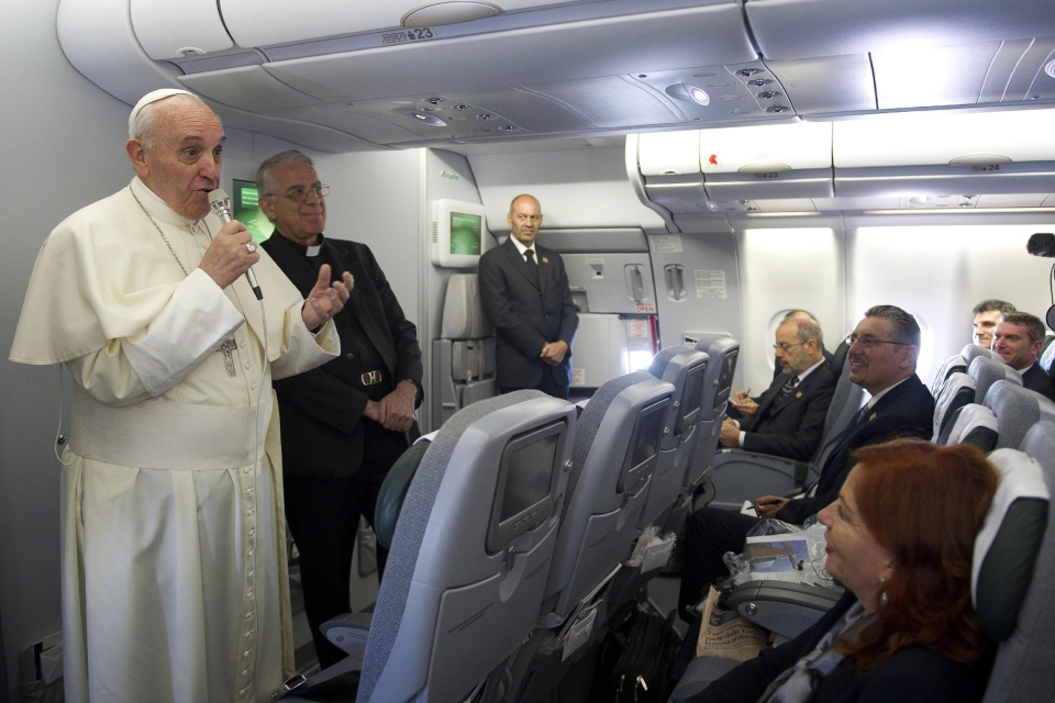 Pope Francis speaks to reporters during the flight to Rio de Janeiro, in Brazil, Monday, July 22, 2013. (L'Osservatore Romano)