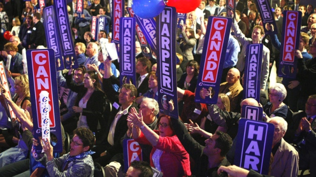 Conservative Party faithful cheer election returns in Calgary on Monday, May 2, 2011. (Jeff McIntosh / THE CANADIAN PRESS)