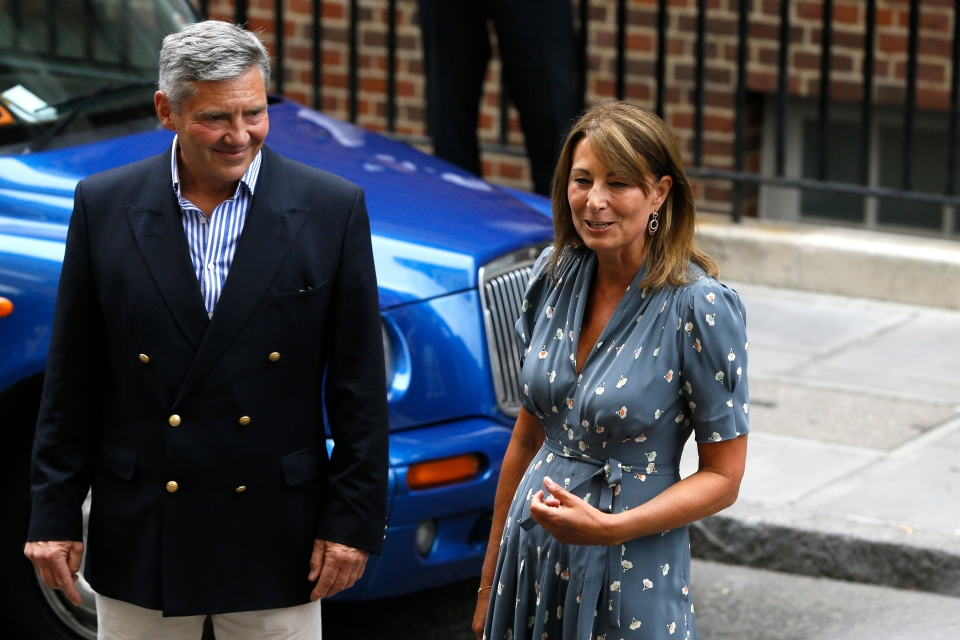 Carole, right, and Michael Middleton, the parents of Kate, Duchess of Cambridge, speak to the media after visiting their daughter at St. Mary's Hospital exclusive Lindo Wing in London, Tuesday, July 23, 2013. (AP / Kirsty Wigglesworth)