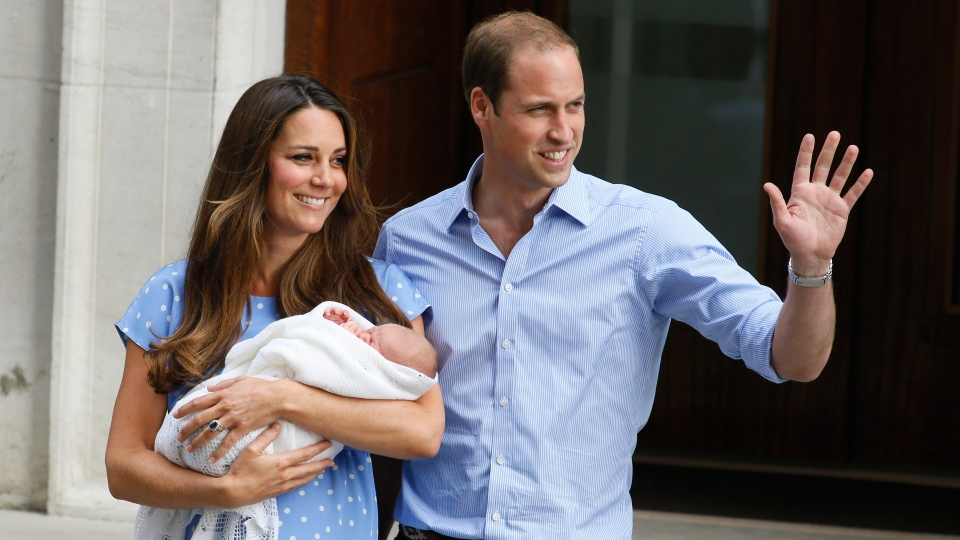 Prince William, right, and Kate, Duchess of Cambridge hold the Prince of Cambridge at. St. Mary's Hospital in London, Tuesday, July 23, 2013. (AP / Kirsty Wigglesworth)