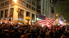 A large, jubilant crowd reacts to the news of Osama Bin Laden's death at the corner of Church and Vesey Streets, adjacent to ground zero, during the early morning hours in New York on Tuesday, May 2, 2011. (AP / Jason DeCrow)