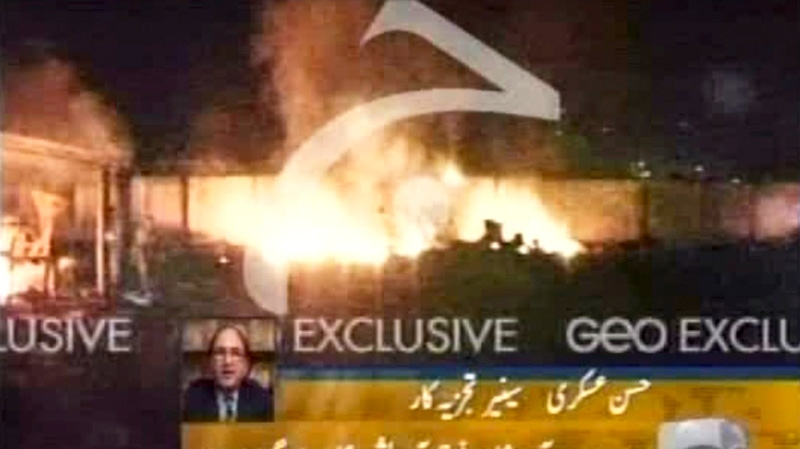 An image made from Geo TV video shows flames at what is thought to be the compound where terror mastermind Osama bin Laden was killed in Abbatabad, Pakistan, Sunday, May 1, 2011. (GEO TV)