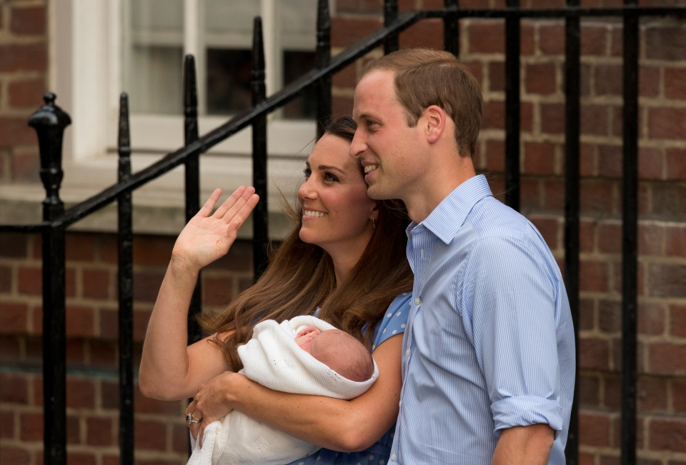 Prince William and Kate, Duchess of Cambridge hold the Prince of Cambridge, as they pose for photographers outside St. Mary's Hospital's exclusive Lindo Wing in London Tuesday, July 23, 2013. (AP / Matt Dunham)