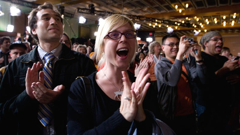 New Democratic Party supporters cheer as they watch results come in from the east coast at NDP leader Jack Layton's election event in Toronto on Monday, May 2, 2011. (Chris Young / THE CANADIAN PRESS)
