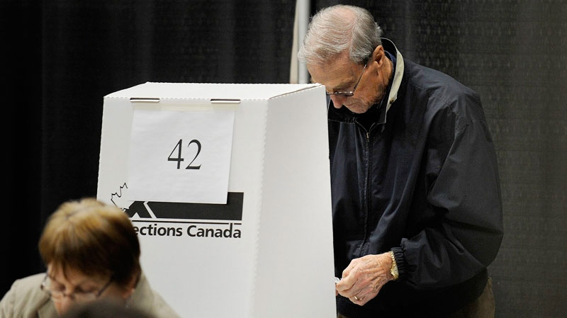Voters take to the polls to cast their ballot in the federal election in Charlottetown, P.E.I. early Monday, May 2, 2011. (Nathan Rochford / THE CANADIAN PRESS)