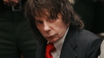 Phil Spector sits in a courtroom for his sentencing in Los Angeles, May 29, 2009. (AP / Al Seib)
