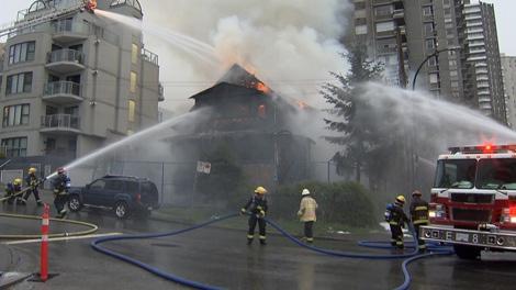 Fire crews battle a three-alarm blaze in the 1400-block of Bute Street. May 2, 2011. (CTV)