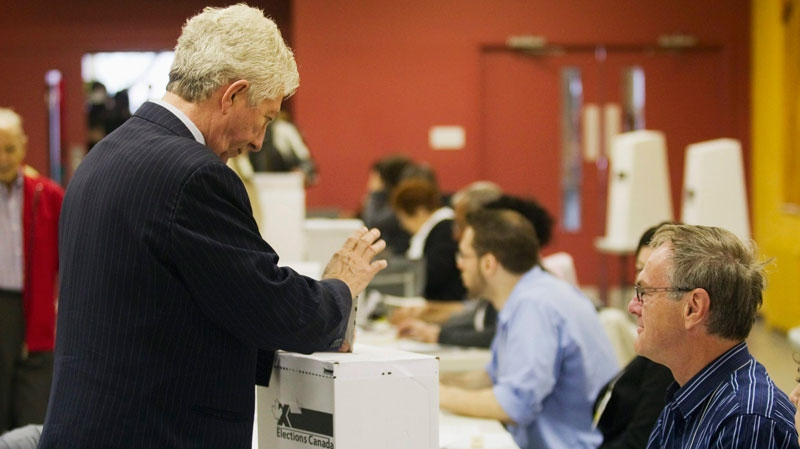Bloc Quebecois Leader Gilles Duceppe, left, casts his ballot in Montreal Que., Monday, May 2, 2011. (Christine Muschi / THE CANADIAN PRESS)