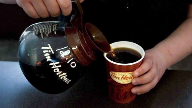 A cup of Tim Hortons coffee is poured in Toronto in this file 2010 photo. (Chris Young / THE CANADIAN PRESS)