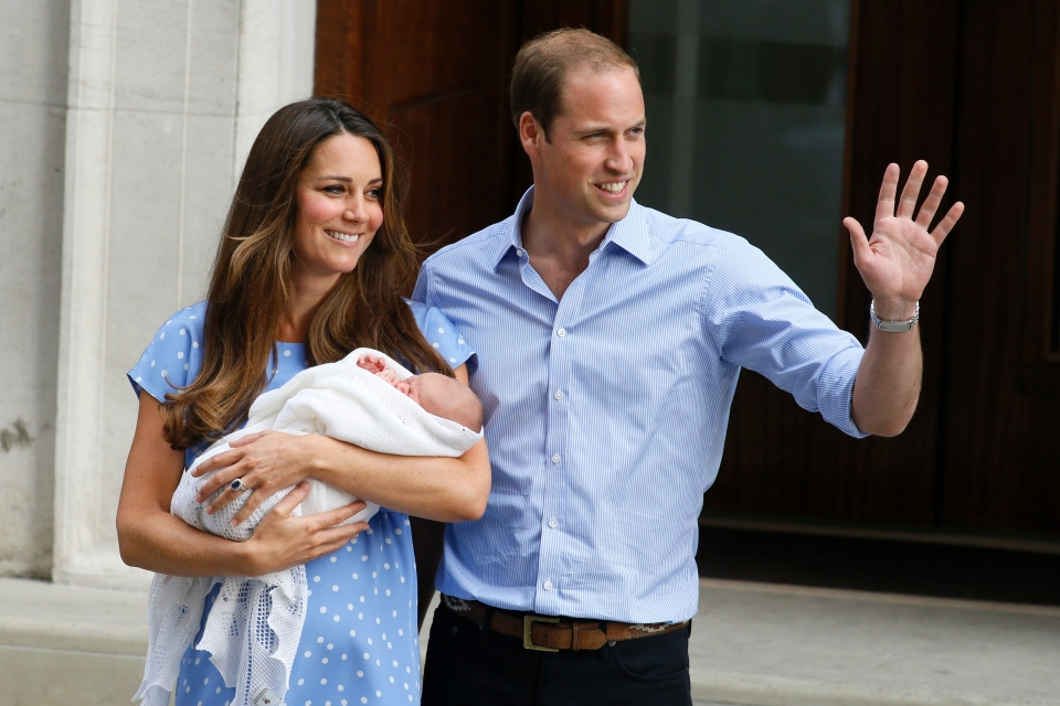 Prince William, right, and Kate, Duchess of Cambridge, hold the Prince of Cambridge outside St. Mary's Hospital, Tuesday, July 23, 2013. (AP / Kirsty Wigglesworth)