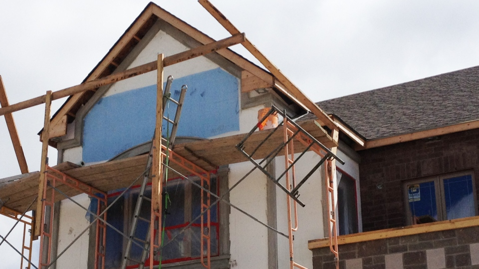 Scaffolding is seen on a house under construction in the Doon South area of Kitchener, Ont., on Wednesday, July 24, 2013. (Nadia Matos / CTV Kitchener)