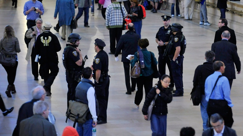 Armed Metropolitan Transportation Authority police officers and city police officer stand among the travellers in New York's Grand Central Station on Monday, May 2, 2011. Security was heightened as a result of the announcement of the killing of Osama bin Laden. (AP / Stephen Chernin)