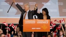 New Democratic Party leader Jack Layton and wife Olivia Chow celebrate their victories at NDP headquarters in Toronto, Ont., Monday, May 2, 2011. (Darren Calabrese / THE CANADIAN PRESS)
