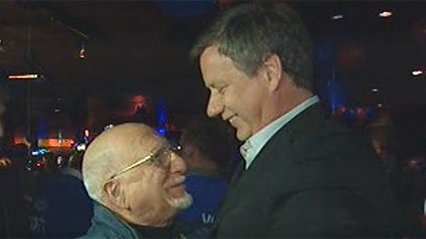 The Conservative's Lawrence Toet (right) greets supporters Monday night.