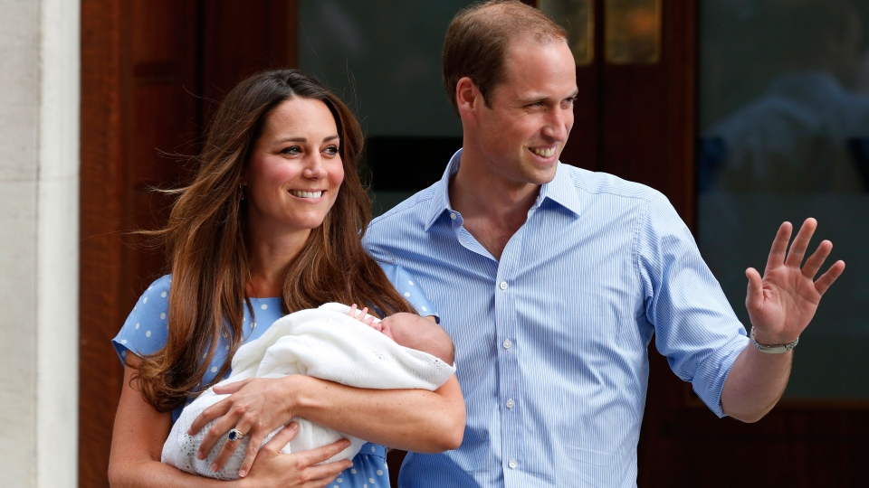 Prince William and Kate, Duchess of Cambridge hold the Prince of Cambridge, as they pose for photographers outside St. Mary's Hospital exclusive Lindo Wing in London Tuesday, July 23, 2013. (AP / Lefteris Pitarakis)