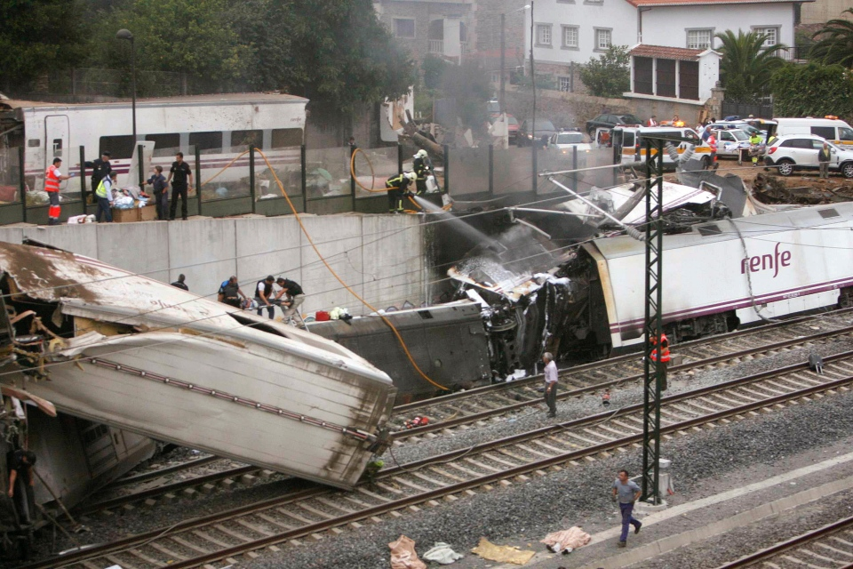 Emergency personnel respond to the scene of a train derailment in Santiago de Compostela, Spain, Wednesday, July 24, 2013. (El correo Gallego / Antonio Hernandez)
