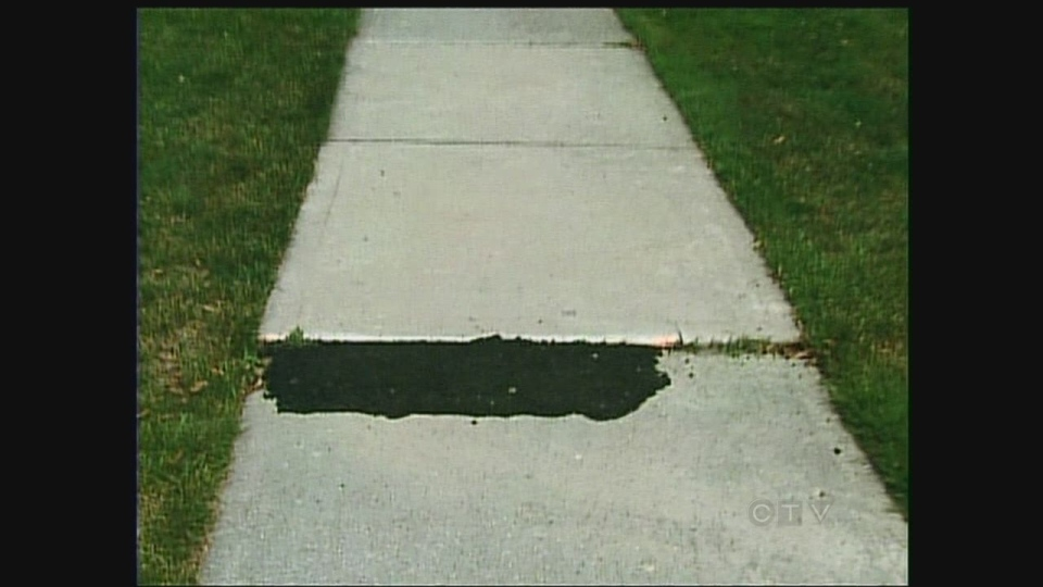 A temporary repair on a sidewalk, which could last for years, is seen in London, Ont. on Wednesday, July 24, 2013.