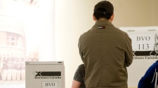 A man waits to cast his vote in Canada's federal election in Montreal, Monday, May 2, 2011. (Graham Hughes / THE CANADIAN PRESS)