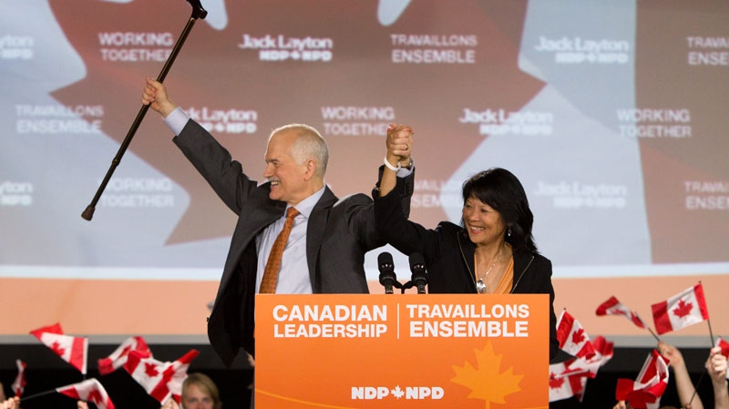 New Democratic Party leader Jack Layton and wife Olivia Chow celebrate their victories at NDP headquarters in Toronto on Monday, May 2, 2011. (Darren Calabrese / THE CANADIAN PRESS)