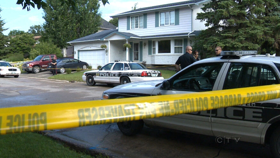 Police tape surrounds a neighbourhood as officers investigate the death of two young children in Winnipeg, Wednesday, July 24, 2013.