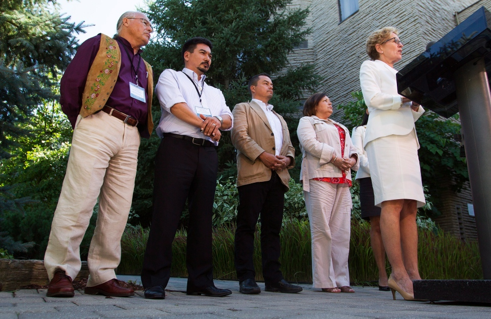 Ontario Premier Kathleen Wynne, right, with leaders of the National Aboriginal Organizations (from left) Clement Chartier, Terry Audla, Shawn Atleo, and Betty Ann Lavallee, speaks to the media following a meeting between the Premiers and National Aboriginal Organizations Leaders in Niagara-on-the-Lake, Ont., Wednesday, July 24, 2013. (THE CANADIAN PRESS/Aaron Lynett)