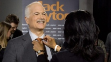 New Democratic Party leader Jack Layton gets his tie adjusted by his wife Olivia Chow, who also won her seat, prior to delivering his election speech in Toronto, Ont., on Monday, May 2, 2011. (THE CANADIAN PRESS/Andrew Vaughan)