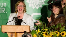 Green Party leader Elizabeth May, left, and her daughter Victoria Cate May Burton celebrate after she was elected MP for Saanich-Gulf Islands in Sidney, B.C., on Monday May 2, 2011. May defeated Conservative incumbent Gary Lunn to become the first Green Party candidate elected to Parliament in Canada. THE CANADIAN PRESS/Darryl Dyck