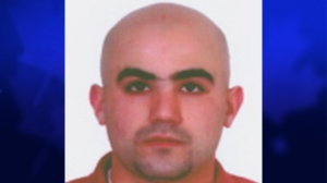 This photo provided by the Bulgarian Interior Ministry on Thursday, July 25, 2013 shows a headshot of Canadian citizen Hassan El Hajj Hassan who is suspected of having link with a bomb attack on the July 18, 2012 at Burgas airport in Bulgaria, that killed five Israeli tourists and a Bulgarian bus driver last year. (AP / Bulgarian Interior Ministry)