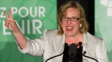 Green Party Leader Elizabeth May gives the victory sign as she speaks to supporters after being elected MP for Saanich-Gulf Islands in Sidney, B.C., on Monday May 2, 2011. May defeated Conservative incumbent Gary Lunn to become the first Green Party candidate elected to Parliament in Canada. (Darryl Dyck /  THE CANADIAN PRESS)
