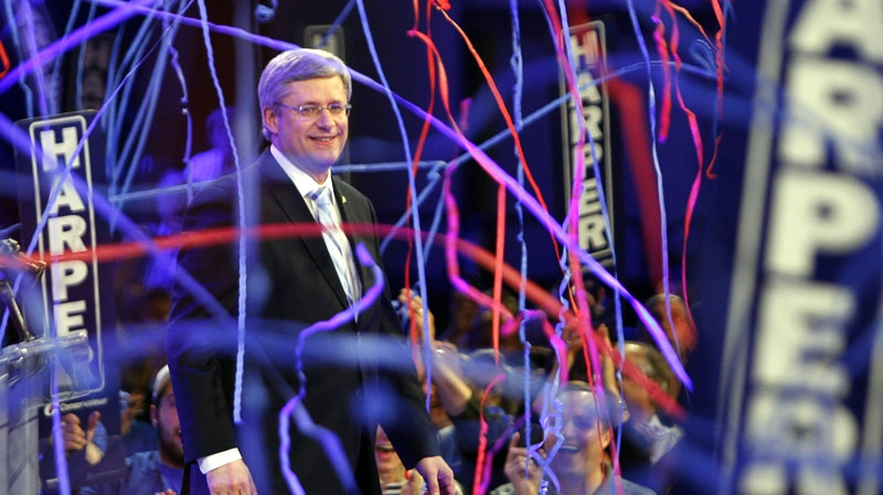 Prime Minister Stephen Harper, waves to party faithful after winning his first majority in Calgary on Monday, May 2, 2011.  (Jeff McIntosh / THE CANADIAN PRESS)