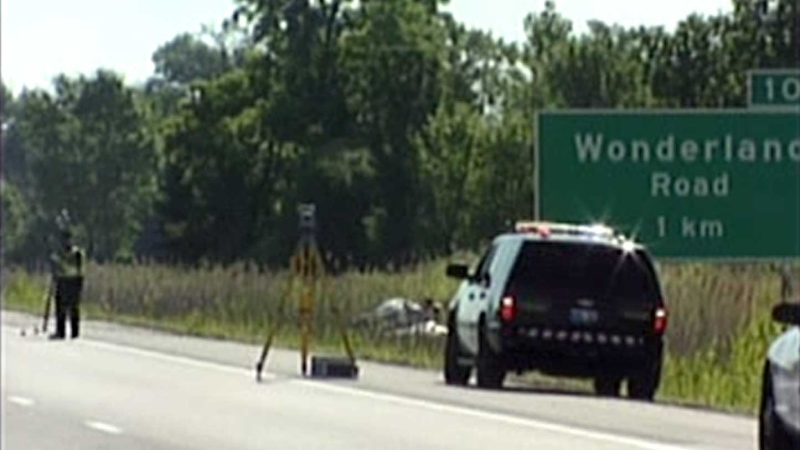 OPP investigators work at the scene of a crash on the eastbound Highway 402 in London, Ont. on Thursday, July 25, 2013.