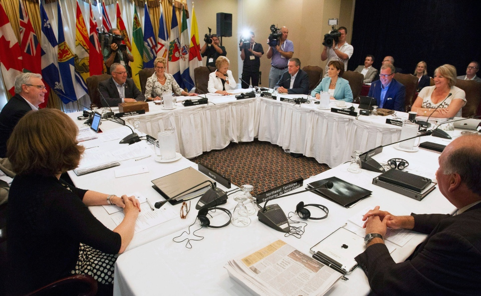 Canada's premiers gather before a morning meeting at the Council of the Federation summer summit in Niagara-on-the-Lake, Ont., on July 25, 2013. (Aaron Lynett/THE CANADIAN PRESS)